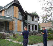 Detroit firemen checkout a vacant building using MICA software loaded into Android smart phones.
