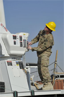 Staff Sgt. Daniel McKinney demonstrates the use of a utility truck's hydraulic system for Afghan electrical engineers and linemen during utility truck training held in early December, in Helmand province, Afghanistan. McKinney, assigned to the U.S. Army Corps of Engineers Prime Power Battalion in Kandahar, Afghanistan, was the lead instructor.