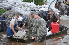 OSCAR, Ky. — Kentucky National Guard members Pfc. David Barrow, Spc. Tommy Wyatt and Pvt. Cedric Bransford, 2113th Transportation Company, assist local residents in flood relief mission here, April 27, 2011.