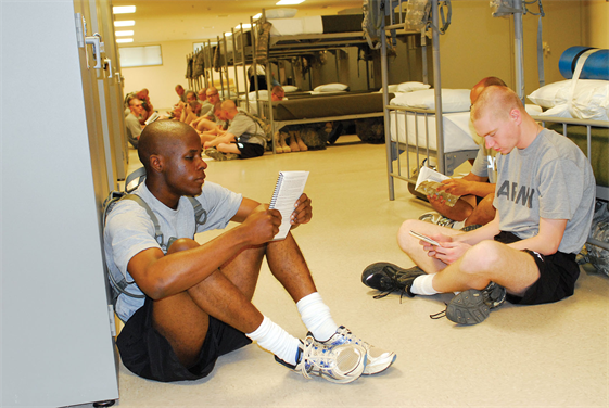 FORT BENNING, Ga. — Pvt. Demarcus Neloms (left), and other Soldiers from the Fitness Training Unit, 30th Adjutant General Battalion (Reception), study in the barracks, Apr. 20, 2012. The Reception Station Barracks on Sand Hill earned 35 of 69 credits within the Leadership in Energy and Environmental Design rating system to reach silver status -- 33 is the minimum for official certification.