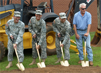 Army officials and the civilian contractor broke ground May 3 for a $10 million dollar expansion at the U.S. Army Combat Readiness/Safety Center at Fort Rucker, Ala.(from left): Brig. Gen. William T. Wolf, director of Army Safety and commander, USACR/Safety Center; Command Sgt. Maj. Richard Stidley, command sergeant major, USACR/Safety Center; Lt. Col. Thomas Nelson, deputy commander, U.S. Army Corps of Engineers Mobile District; and Gary Danford, Bates Engineers/Contractors Inc., Bainbridge, Ga.