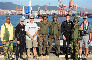 Flanked by members of the Republic of Korea (ROK) Army who served as boat crew for the USACE Forward Response Dive Team during their October underwater inspection of Pier 8 in Busan are (from left to right) Shanon Chader of Buffalo District, Team Lead Todd Manny of Portland, Kyle Tanner of Nashville and Ed Gawarecki of Buffalo.