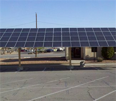 This carport at Fort Hood, Texas, not only helps keep cars cool from the scorching Texas sun, it also generates solar power to keep the buildings cool on the inside and reduce the energy bills throughout the military facility.