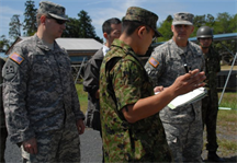 The Japan Ground Self-Defense Force staff briefs Lt. Col. James C. Horton Jr., the deputy commander of the Japan Engineer District, and Capt. Thomas Douglas, JED's Forward Engineer Support Team leader, on equipment displayed at the JGSDF's Engineer School at Camp Katsuta in Ibaraki Prefecture.