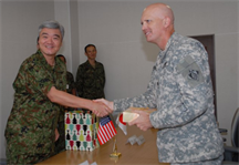 Lt. Col. James C. Horton Jr. presents a gift to Japan Ground Self-Defense Force Maj. Gen. Masafumi Akamatsu, commandant of the JGSDF's Engineer School, during a visit to Camp Katsuta in Ibaraki Prefecture.