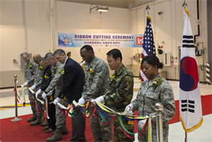 Leaders and representatives from Kunsan Air Base, the Far East District, and the Ministry of National Defense Installations Agency cut the ribbon on the final phase of a new maintenance complex Dec. 18 completed by the U.S. Army Corps of Engineers Far East District. This new complex consolidates maintenance facilities which were spread out over the air base.