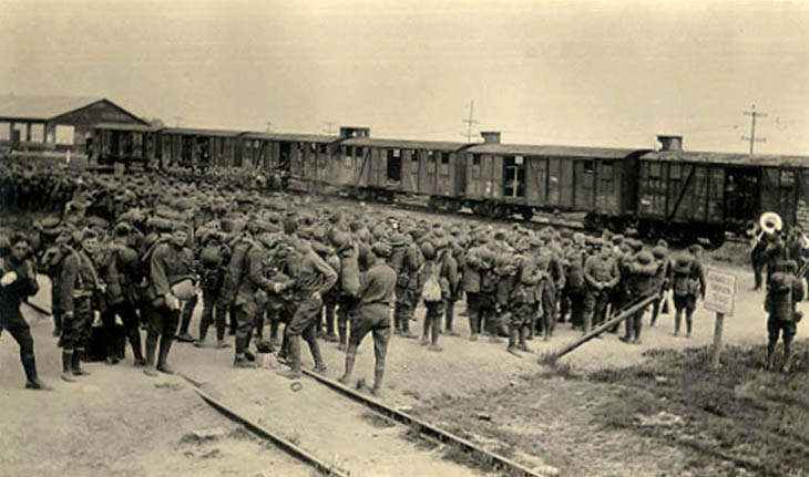 Soldiers preparing to board trains in France