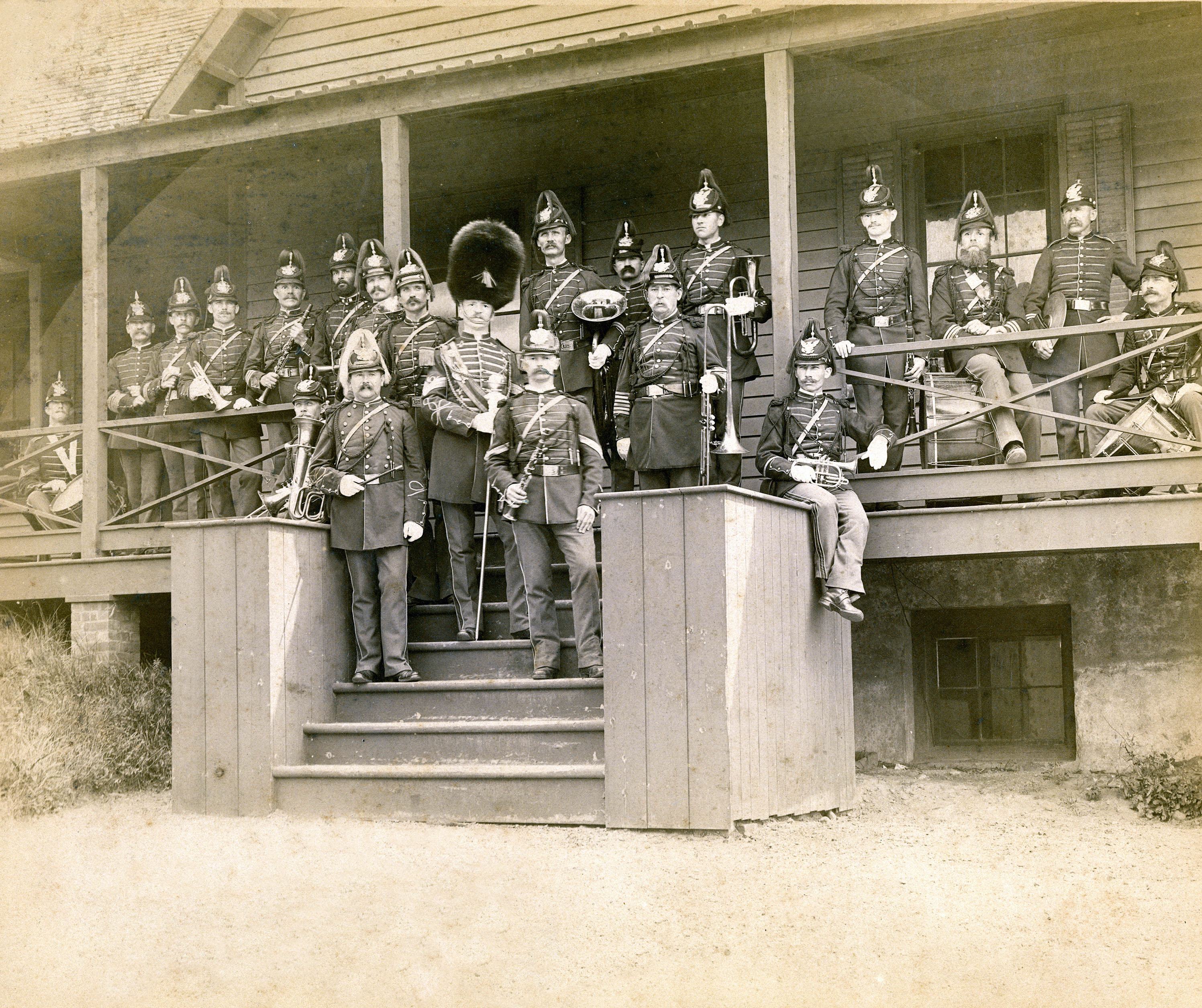 Band on steps of photo lab building