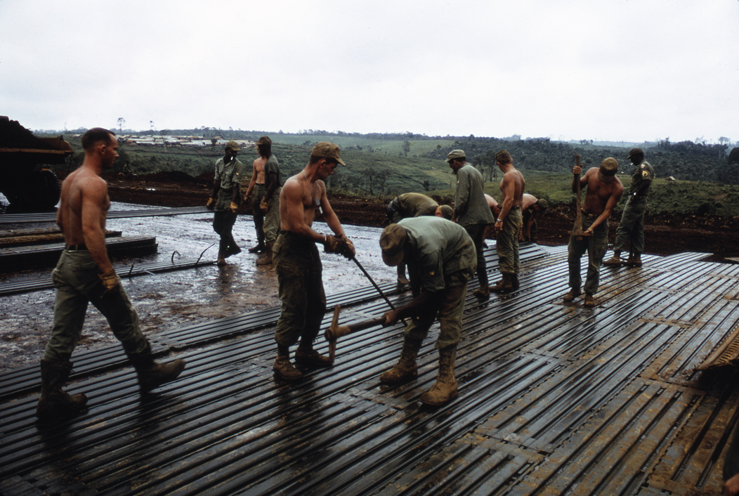 Soldiers working on laying a runway