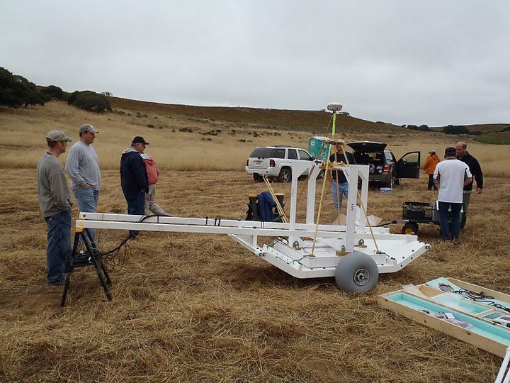 During July 2011, U.S. Army Corps of Engineers employees participate in hands-on MetalMapper training at the former Fort Ord military base in the Monterey Bay area of California. The device provides a new classification technology for sub-surface anomalies on Formerly Used Defense Sites, and is expected to help technicians better distinguish between unexploded ordnance and other metals beneath the soil.  This training focused on how to get the device up and running to acquire data. (Courtesy photo)