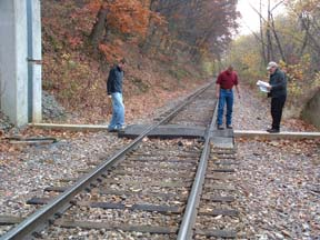 Inspection team evaluating a closure sill.