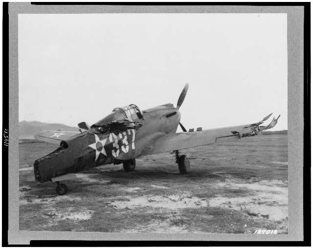 A wrecked P-40 at Bellows Field following the bombing on 7 Dec 1941