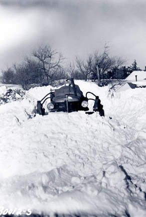 snowmobile-like tractor on snow dune