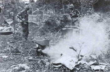 Engineers unpack and test a Mitey-Mite blower in the Vietnamese jungle